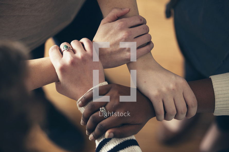 Interlocked hands.