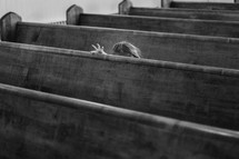 a child sitting in a church pew