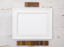 frame with happy thanksgiving wood stamps