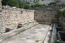 These are the public toilets at the ruins from Ancient Philippi. These toilets date to the 3rd century AD. Philippi was the home of Lydia the merchant who befriended the Apostle Paul in Acts 16 of the Bible.