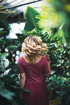 a woman walking through a garden center