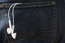 Ear buds hanging out of a back pocket.