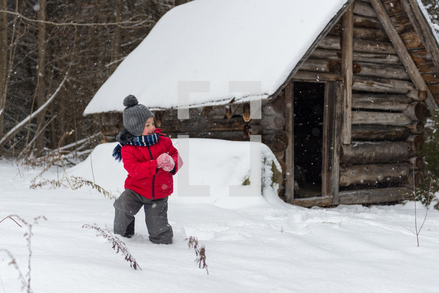 boy child throwing a snowball