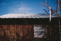 a tin roof and window on a home