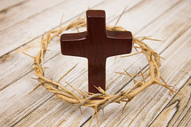 crown of thorns around a wooden cross