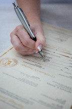 Completing a marriage license.
