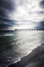 pier on a stormy beach