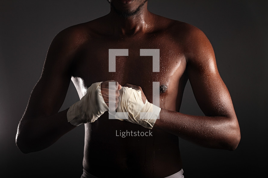 fighter with hands wrapped in tape