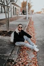 a man sitting on a curb