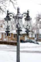 ice on a street lamp