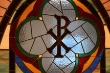 stained glass window of chi and rho ΧΡ for the Greek word ΧΡΙΣΤΟΣ Christ