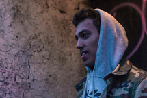 young man in a hoodie with copy space