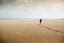 a man walking on a beach