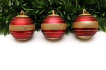gold and red ornament and garland