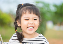 laughing Asian child