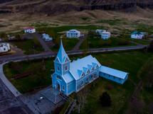 aerial view over a blue church