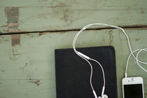 Bible and iPhone and earbuds