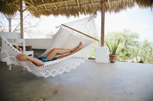 man napping in a hammock