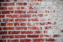 brick wall with white paint faded away background