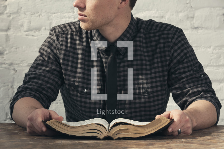 A man holding an opened Bible