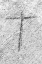 smudge cross on concrete