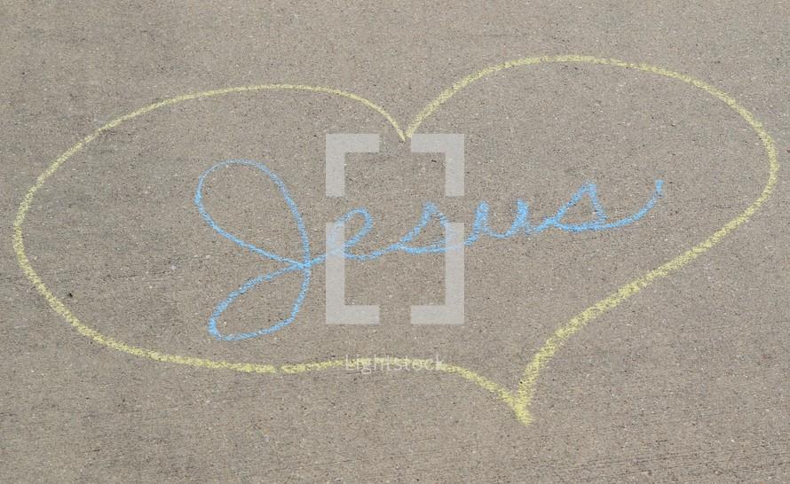 word Jesus with heart in sidewalk chalk