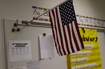 An American flag in a classroom