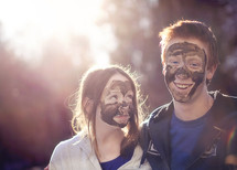 children with mud on their faces