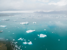 aerial view over icebergs