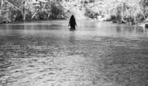 woman walking through a river