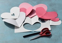 construction paper, scissors, and marker to make homemade Valentine's day cards
