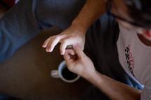 man with coffee mug on Christmas morning