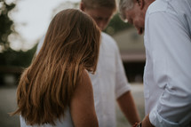 family holding hands praying together