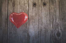 A red heart on wood