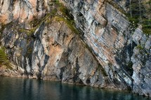 side of a cliff and water