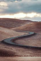 curvy road on desert mountains