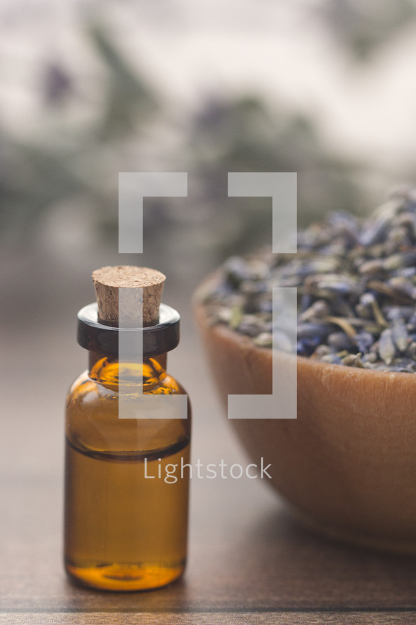 essential oil bottle and dried lavender