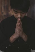 head bowed in prayer