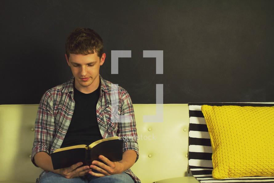 teen boy reading a Bible