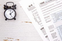 clock and tax forms