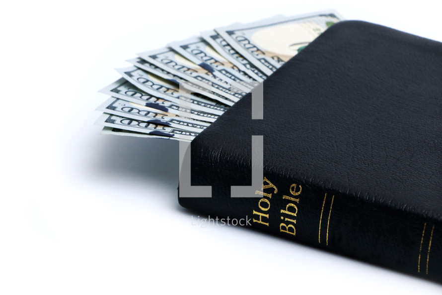 Ten one hundred dollar bills in a Bible.