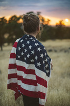 a woman with an American flag around her shoulders