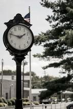 clock on a downtown sidewalk