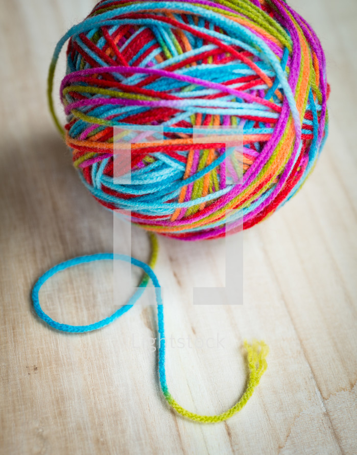 ball of rainbow colored yarn
