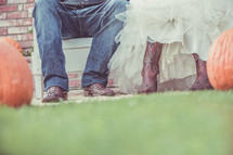 bride and groom in cowboy boots