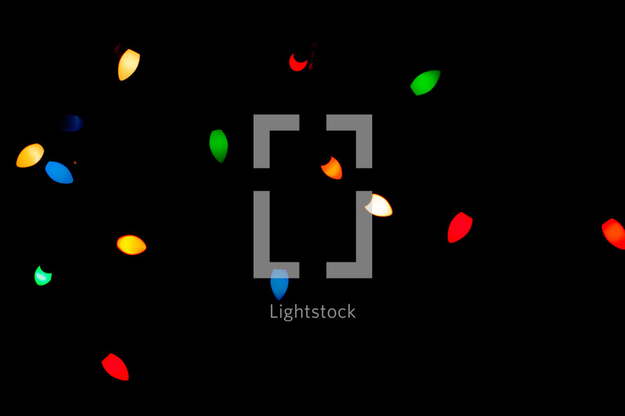 glowing Christmas lights in darkness
