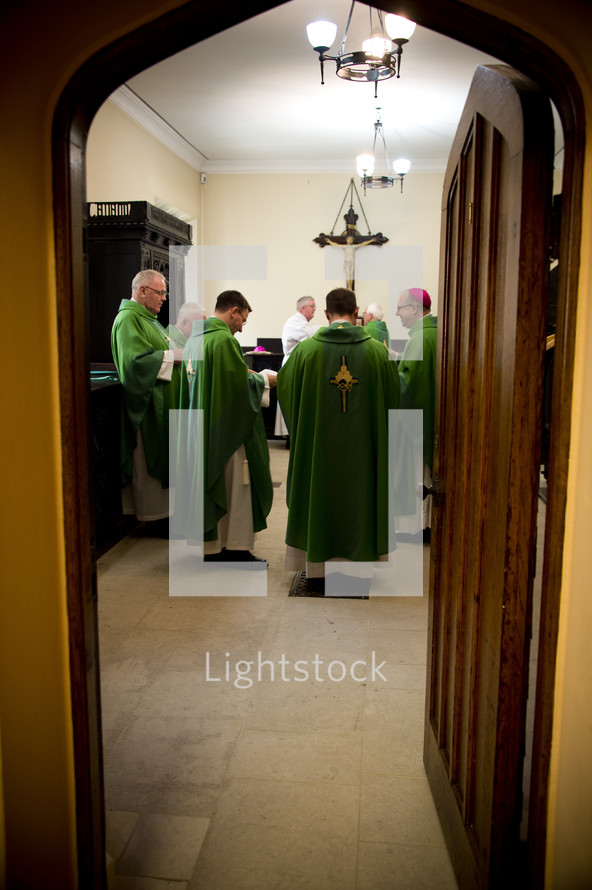 priests and bishops in prayer