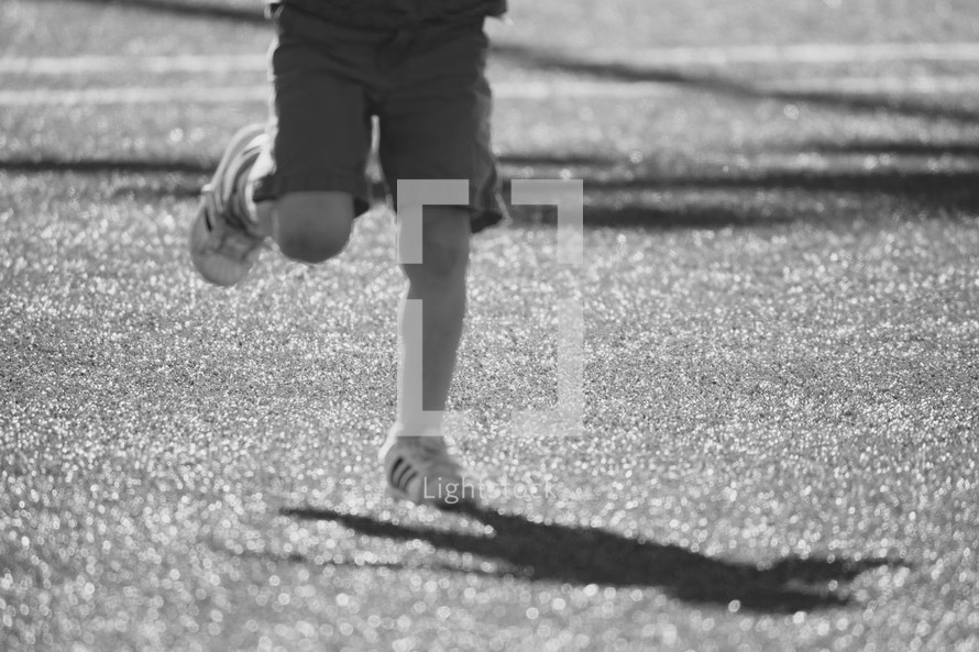 a child running on astroturf