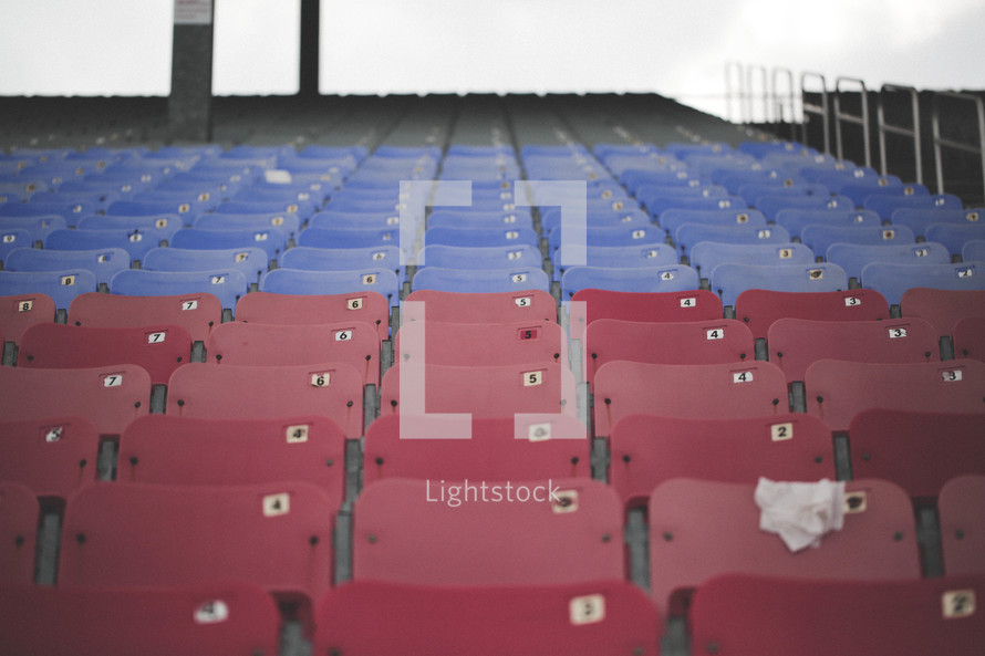 Red and blue seats in a sports stadium.