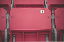 Red stadium seats.